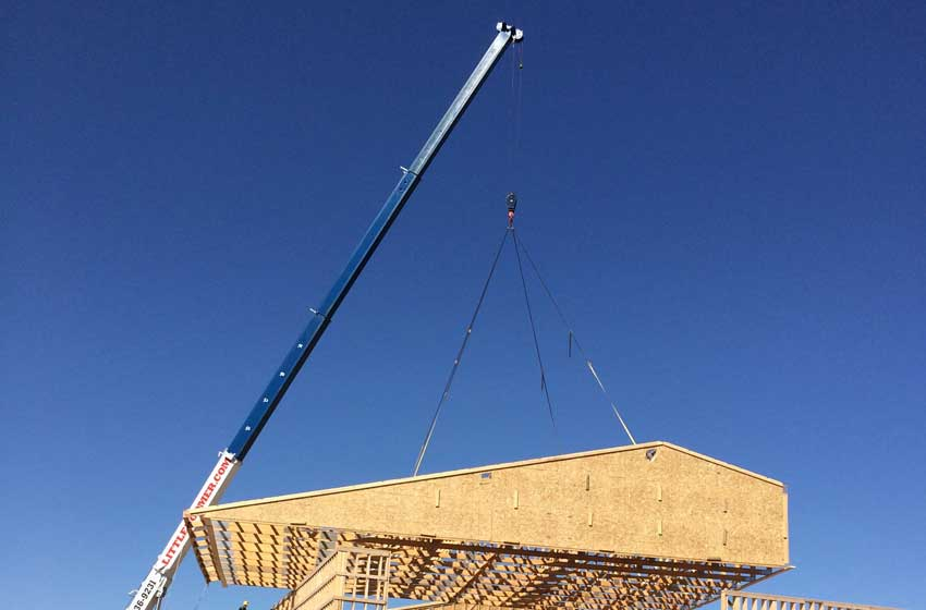 Hoisting roof trusses